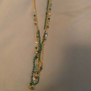 Long gold and blue bead necklace